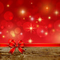 Red ribbon bow with bokeh christmas decoration this is file of eps format Royalty Free Stock Photos