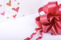 Bouquet of red tulips decorated with hearts ribbon isolated over white. Valentines Day concept