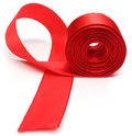 Red ribbon closeup of roll over white background Royalty Free Stock Image