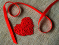 Red ribbon and heart Stock Photos