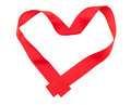 Red ribbon in heart shape Stock Photos