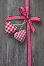 Red ribbon with hearts on a wooden background Stock Image