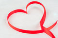 Red ribbon, lined in shape of heart