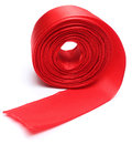 Red ribbon roll closeup of over white background Stock Photography