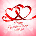 Red ribbon with two hearts intertwined in a shape of on a pink background Stock Photography