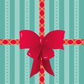 Red Ribbons and Bow Tied on Striped Gift Wrapping Paper Royalty Free Stock Photo