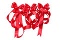 Red ribbons white isolated background of bow Stock Photos