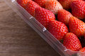 Red ripe strawberry in plastic box of packaging Royalty Free Stock Photo