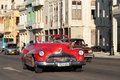 Red roadster on malecon havana cuba february classic old american car in the streets of havana classic cars are still in use in Royalty Free Stock Photo