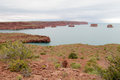Red rocks in the blue lake water Royalty Free Stock Photo