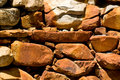 Red rocks in landscaped wall Royalty Free Stock Image