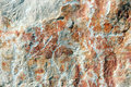 Red rocky surface and white stone background Royalty Free Stock Image