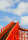 Red rollercoaster with track and chain leading up Stock Images
