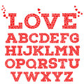 Red romantic alphabet with love inscription made of small red heart shapes on white background.