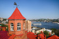 Red roof of brick building, port Vladivostok, panorama of Zolotoy rog bayl, Russia Royalty Free Stock Photo