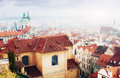 The red roof in Prague. Panoramic view of  from  Castle, Czech Republic. Summer day with blue sky  clouds and dense fog Royalty Free Stock Photo