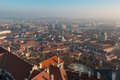 The red roof in Prague. Panoramic view of Prague in winter day with dense fog in the city. Royalty Free Stock Photo