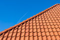 Red roof tiles on blue sky Royalty Free Stock Photography