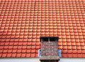 Red roof tiles with chimney Stock Photo