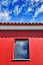 Red roof under blue sky Stock Image