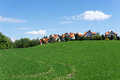 Red roofed houses on a green hill Royalty Free Stock Photo