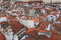 Red rooftops of lisbon portugal buildings cluster city with shallow depth field Stock Photos