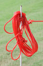 The red rope on iron prong pole.