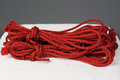 Red ropes for bondage of jute or shibari Royalty Free Stock Photography