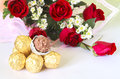 Red rose flower bouquet with chocolate ball Royalty Free Stock Photo