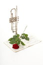 Red rose and old notes sheet music trumpet note love white background Royalty Free Stock Photos
