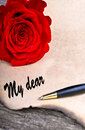 Red rose on old woodlove letter concept on wood table Royalty Free Stock Photo