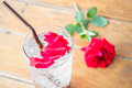 Red rose petals decorated iced pomegranate drink stock photo Stock Image