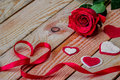 Red rose with ribbon and heart