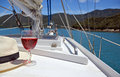 Red rose wine panama hat summer luxury a glass of and a on the deck of a yacht in the marlborough sounds new zealand Stock Photos