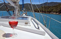 Red rose wine on a yacht in the marlborough sounds summer luxury glass of deck of new zealand Stock Images