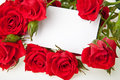 Red roses and blank invitation card Stock Photo