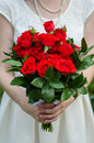 Red roses bouquet bride with in her hands Stock Images