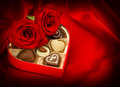 Red roses and chocolate candy. Gift box. Heart. Love Royalty Free Stock Photo