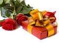 Red roses with gift Royalty Free Stock Image