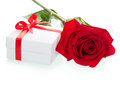 Red roses with gift box on white background Stock Photos