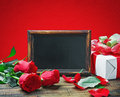 Red roses and gift for Valentine's Day or a birthday Stock Image
