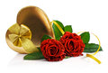 Red roses and golden gift box in heart shape Royalty Free Stock Photo