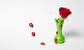Red roses in a green vase on white background with bugs Stock Photos