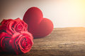 Red Roses with hearts on old wooden board, Valentines Day Royalty Free Stock Photo