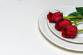 Red Roses on a plate. Romantic composition for Valentine`s Day, Anniversary, Events. Place for text