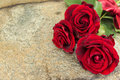 Red roses on stone table Royalty Free Stock Photo