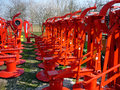 Red rotary mowers machine farm Royalty Free Stock Photos