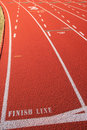 Red rubber track finish line Royalty Free Stock Image