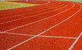 Red Running track with corner of the football field. Royalty Free Stock Photo