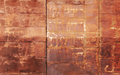 Red rusted metal wall texture with welds Stock Image